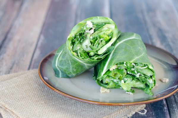 15 minute Caesar salad lettuce wraps. Perfect for really busy nights or a quick meal on the go. Made with collard green wraps, Parmesan cheese crisps, Caesar dressing, chicken and fresh crisp lettuce. Low-carb, ketogenic, gluten-free, grain-free, primal.