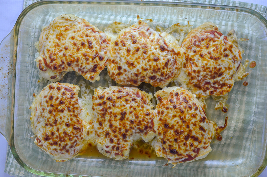 Gluten-free grilled chicken Parmesan. The chicken is seasoned and grilled, then topped with tomato sauce, Parmesan and mozzarella cheese and broiled until the cheese is bubbly and browned. Serve with your favorite vegetable and a gluten-free pasta of choice, and you have a perfect meal! Gluten-free, grain-free, low-carb, ketogenic.