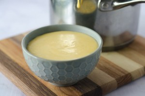 A delicious and incredibly simple queso dip. All you need is heavy cream or coconut milk, cheese and jalapenos. Simply simmer to thicken the milk and stir in the cheese and jalapenos. It doesn't get much easier! Gluten-free, grain-free, ketogenic, low-carb.