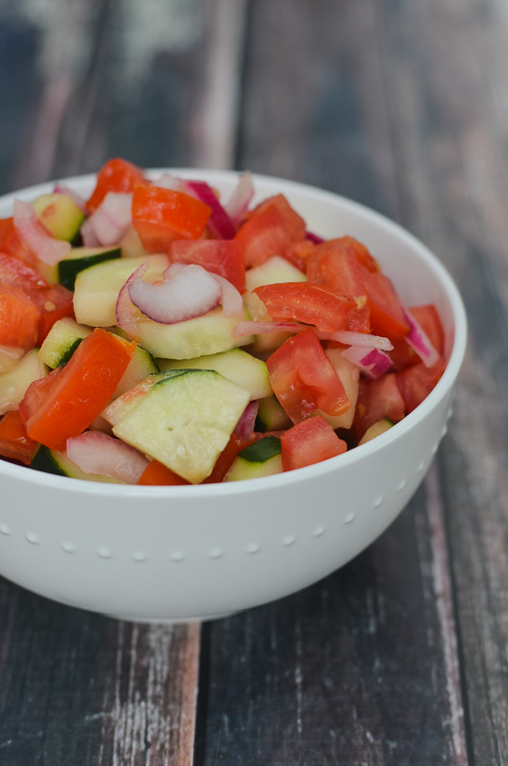 The perfect accompaniment to some summer BBQ, this simple tomato, onion and cucumber salad is incredibly simple and delicious! Vegan, gluten-free, grain-free, dairy-free, Whole30, Paleo, ketogenic, low-carb.