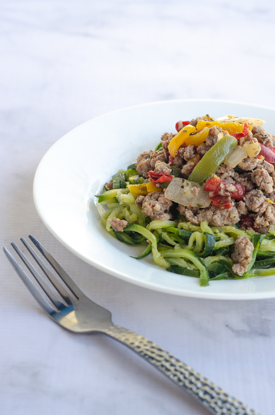 This Italian sausage, peppers and onions with zucchini noodles is a simple meal for super-busy nights. Keto, low-carb, Paleo, Whole30, gluten-free, grain-free, dairy-free.
