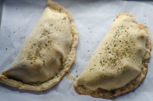 Looking for a hearty, cheesy meal but trying to avoid the carbs and grains? This tomato basil and spinach calzone is delicious and healthy! Low-carb, vegetarian, gluten-free, grain-free.