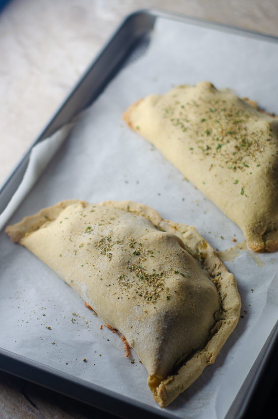 Looking for a hearty, cheesy meal but trying to avoid the carbs and grains? These tomato basil and spinach calzones are delicious and healthy! Low-carb, vegetarian, gluten-free, grain-free.