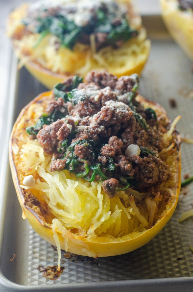 This spaghetti squash with meat sauce is a healthy alternative to a carb-filled dinner. Low-carb, paleo, whole30, gluten-free, grain-free, dairy-free.