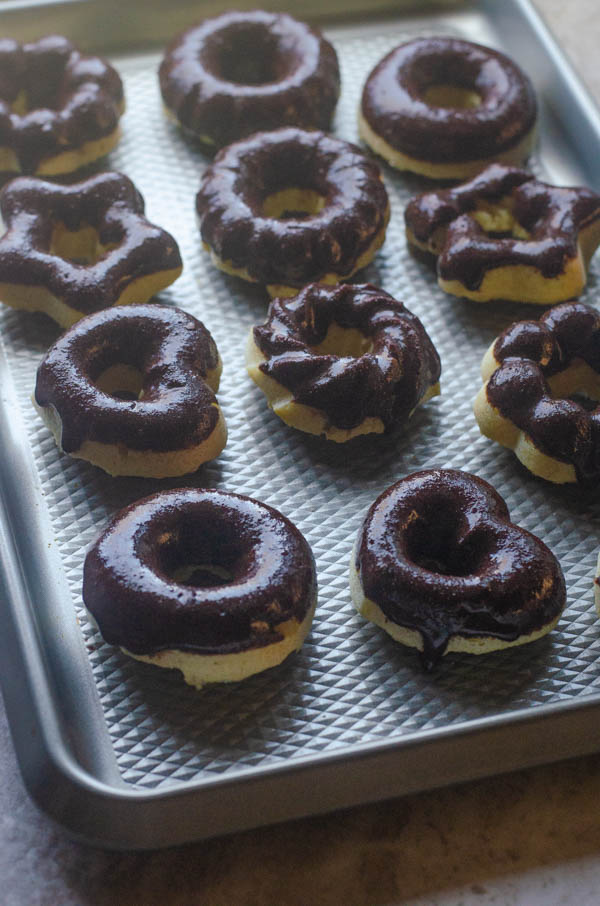 Keto chocolate frosted donuts are a delicious breakfast, dessert or snack! They are paleo, low-carb, sugar-free, dairy-free and grain-free.