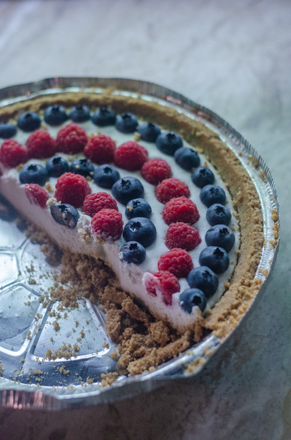 This 4th of July coconut cream pie is the epitome of a delicious summer dessert! It is light, creamy and full of fresh berries. Gluten-free, vegan, dairy-free.