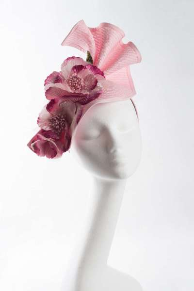 Pink fascinator with flower bunch