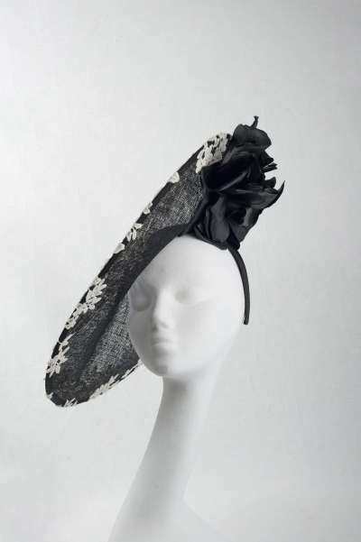 large disc black with white lace hat with large flower - The Hat Box