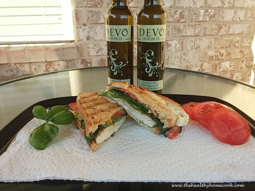 Tuscan herb Panini- This toasted turkey sandwich with fresh tomatoes, romaine lettuce, and a tasty white balsamic aioli is incredibly flavorful and the perfect low calorie recipe.