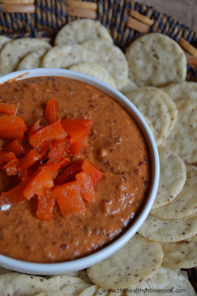 Roasted red pepper bean dip- Perfectly creamy, smokey, and just a little bit spicy! This dip is so addicting, EVERYONE will want the recipe.