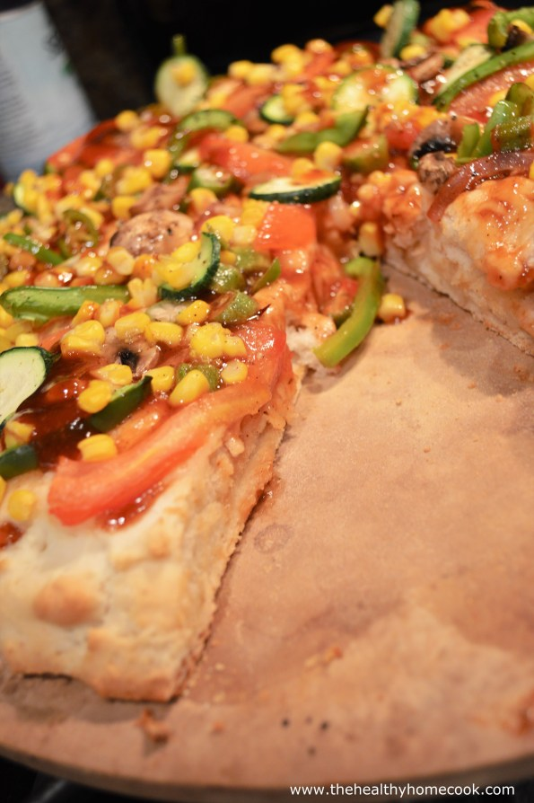 This Thick Crust BBQ Garden Pizza has a soft, flaky crust that is overflowing with healthy vegetables and tangy bbq sauce.
