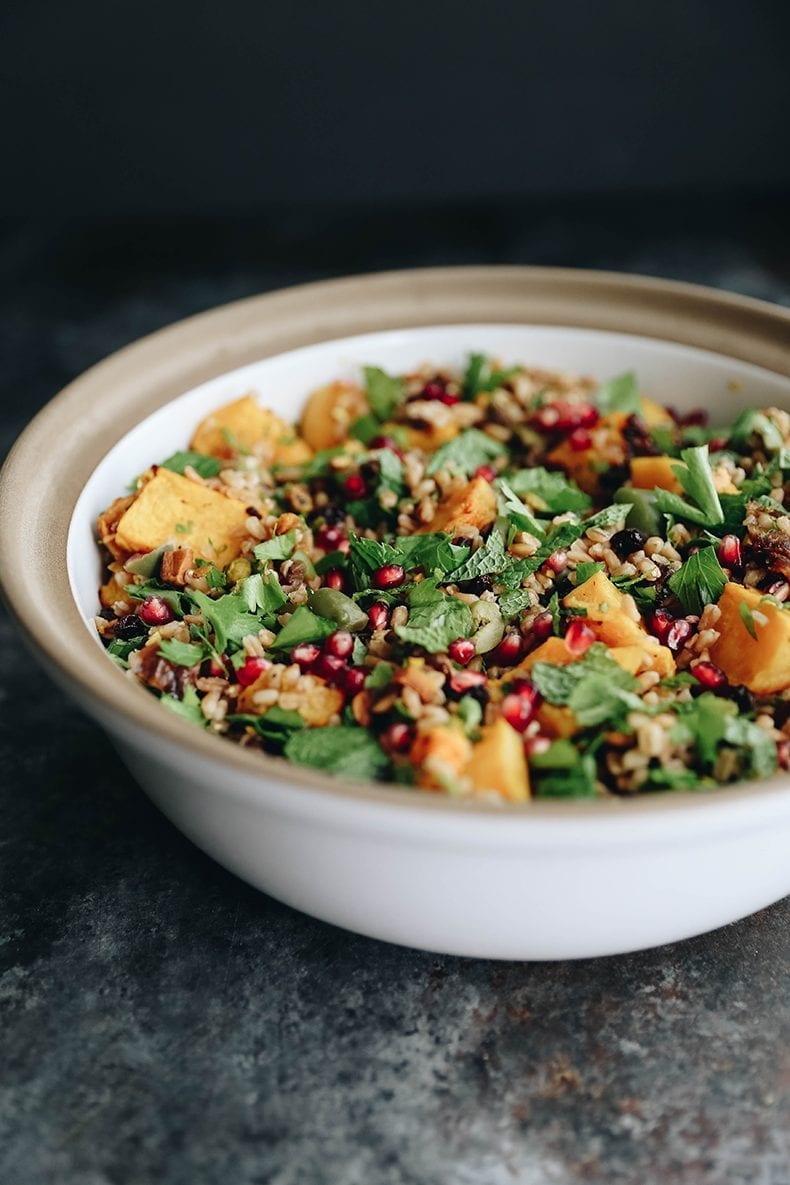 Get the most of fall with this Farro harvest salad with toasted butternut squash and a pomegranate molasses dressing.  A seasonal favorite packed with nutrients and delicious flavors for a side or main course!  #salad #farro #grainsalad