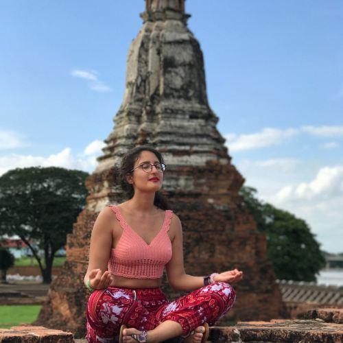 girl meditating in thailand