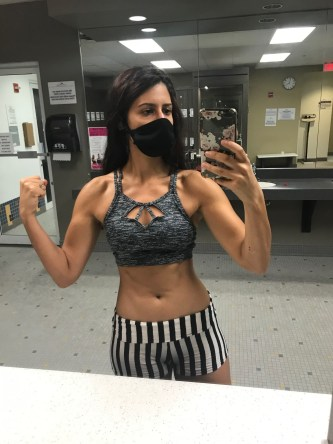 woman with workout top and mask