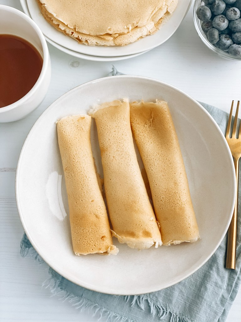 Rolled scandinavian pancakes on a plate