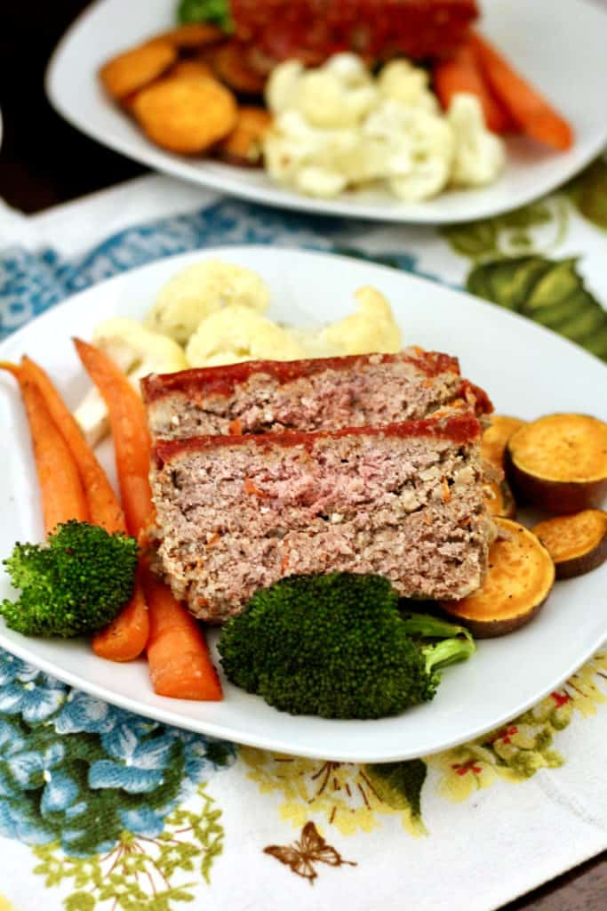 Slices of healthier bison meatloaf with veggies