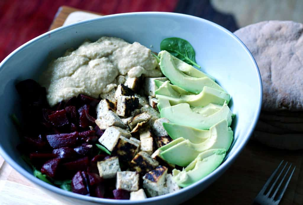 Lemon hummus stuffed salad with avocado and beets