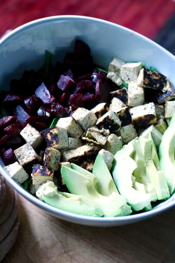 Tofu beet and spinach salad with avocado