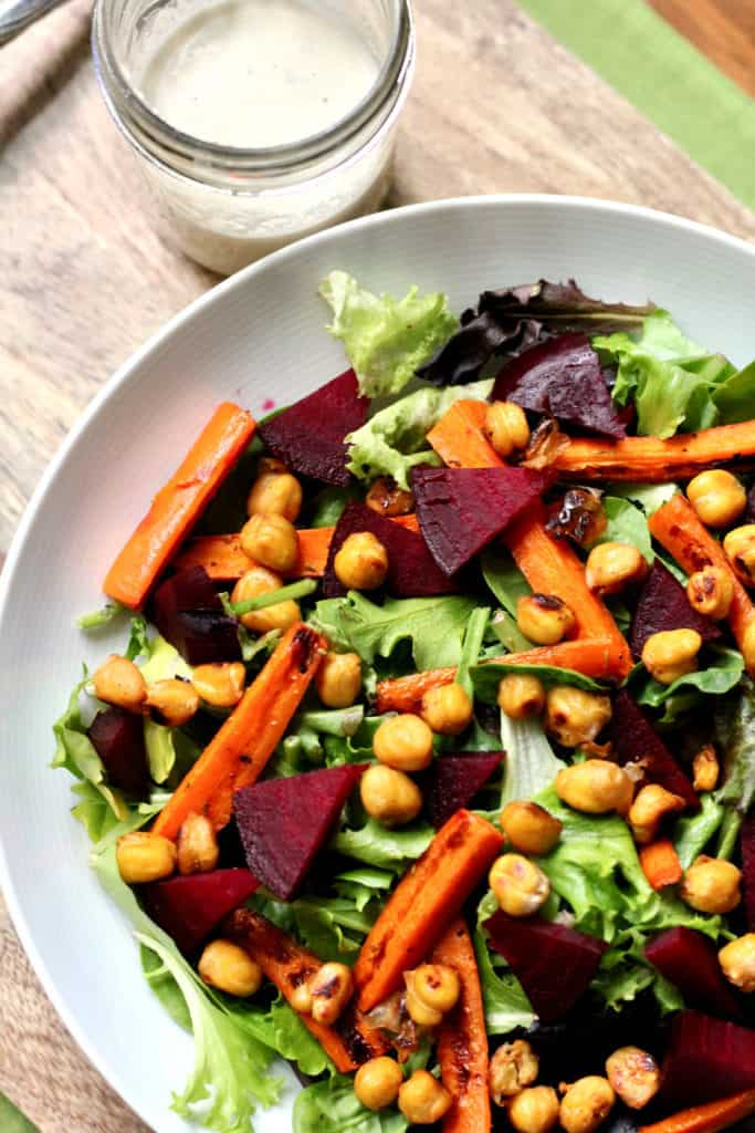 Roasted spring vegetable salad with crispy chickpeas and creamy cashew dressing on the side