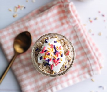 Birthday cake overnight oats in mason jar with greek yogurt and sprinkles on top
