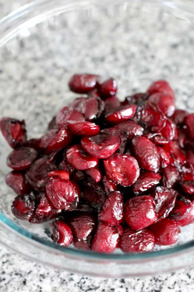 Roasted balsamic cherries in bowl