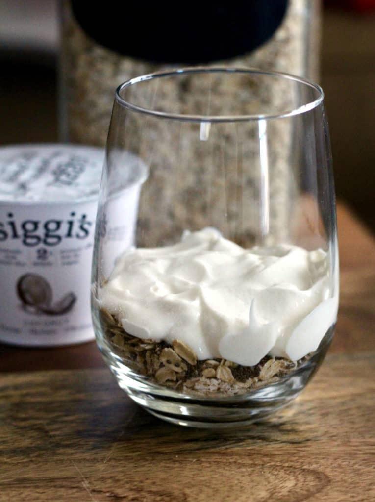 Layering oats, chia seeds, and siggis coconut Icelandic yogurt