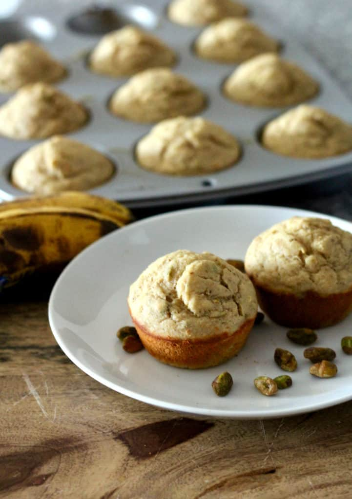 Whole wheat banana pistachio muffins on a plate