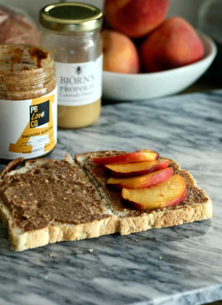 Almond butter and peaches on sourdough bread