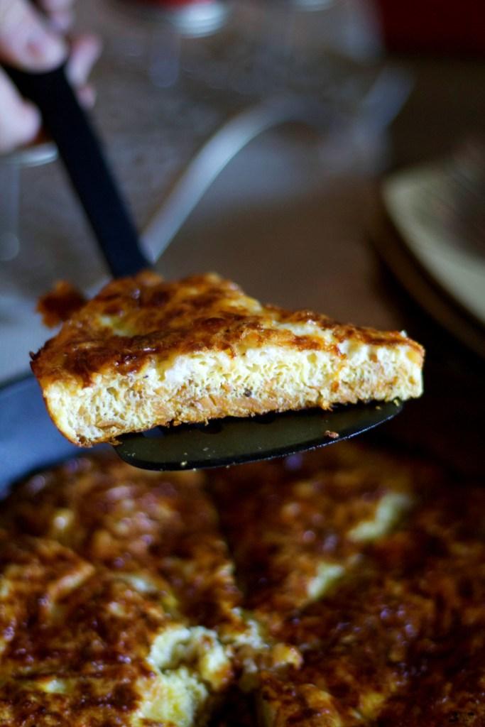 Slice of sweet potato frittata on spatula