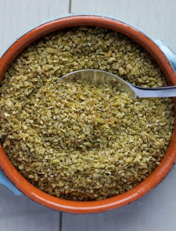 Cracked Freekeh in Bowl with Spoon