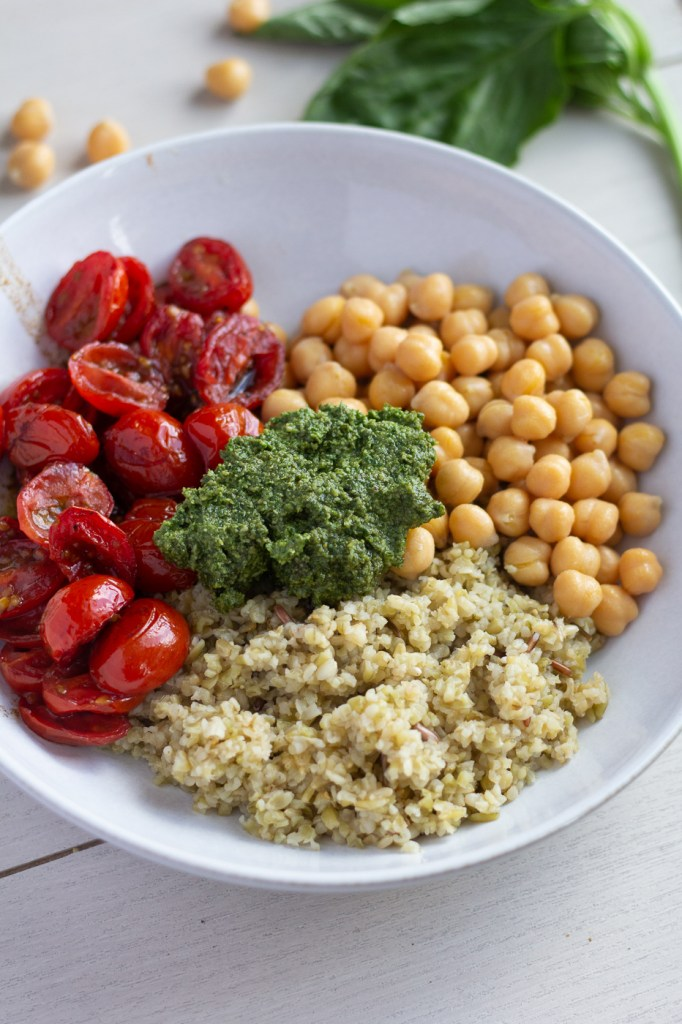 Mediterranean Pesto Bowl with roasted balsamic cherry tomatoes, homemade walnut pesto, chickpeas and freekeh