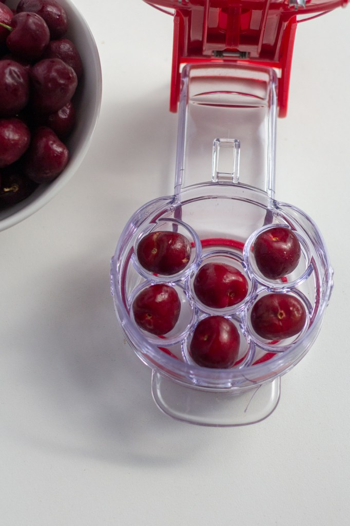 Cherries in a cherry pitter