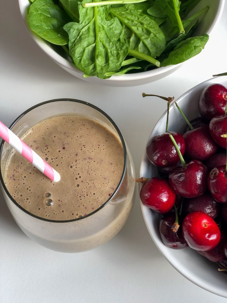 Glass of spinach cherry smoothie