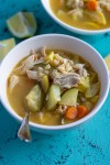Bowl of lemon chicken soup with barley, carrots, and summer squash