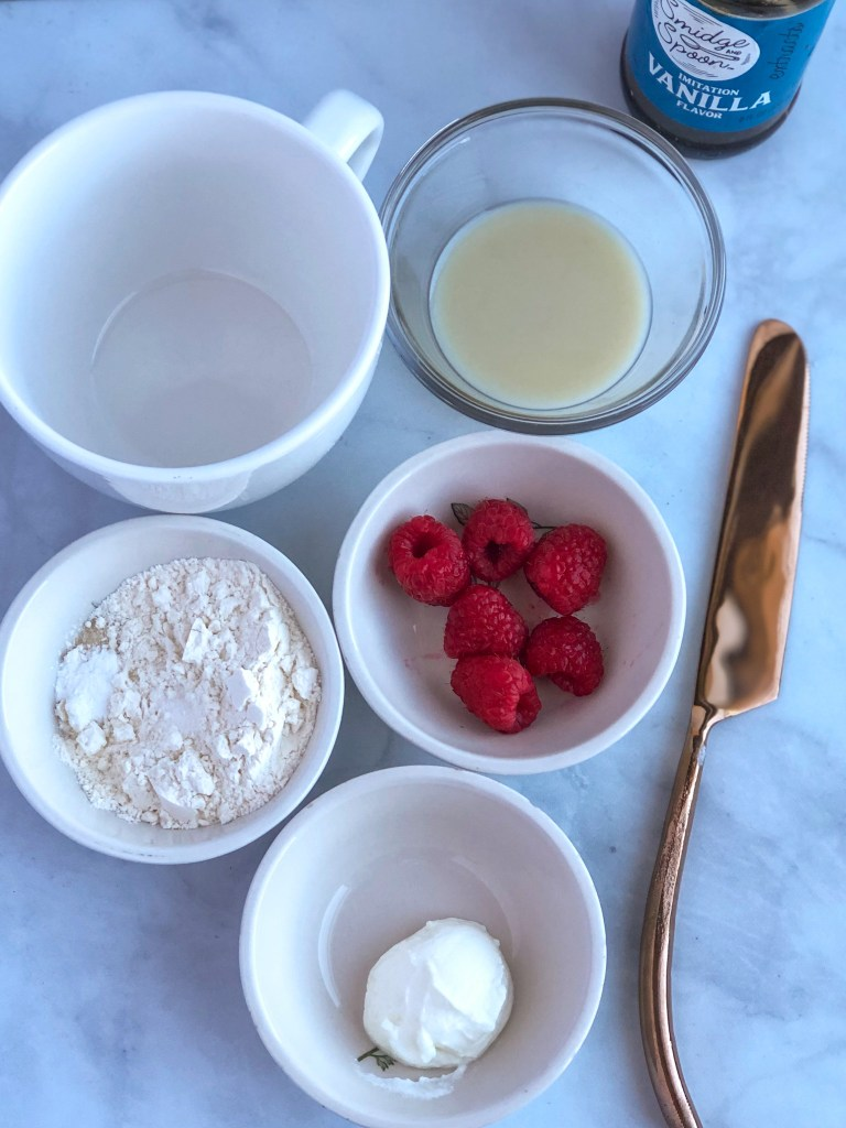 Ingredients for healthy raspberry mug cake for one
