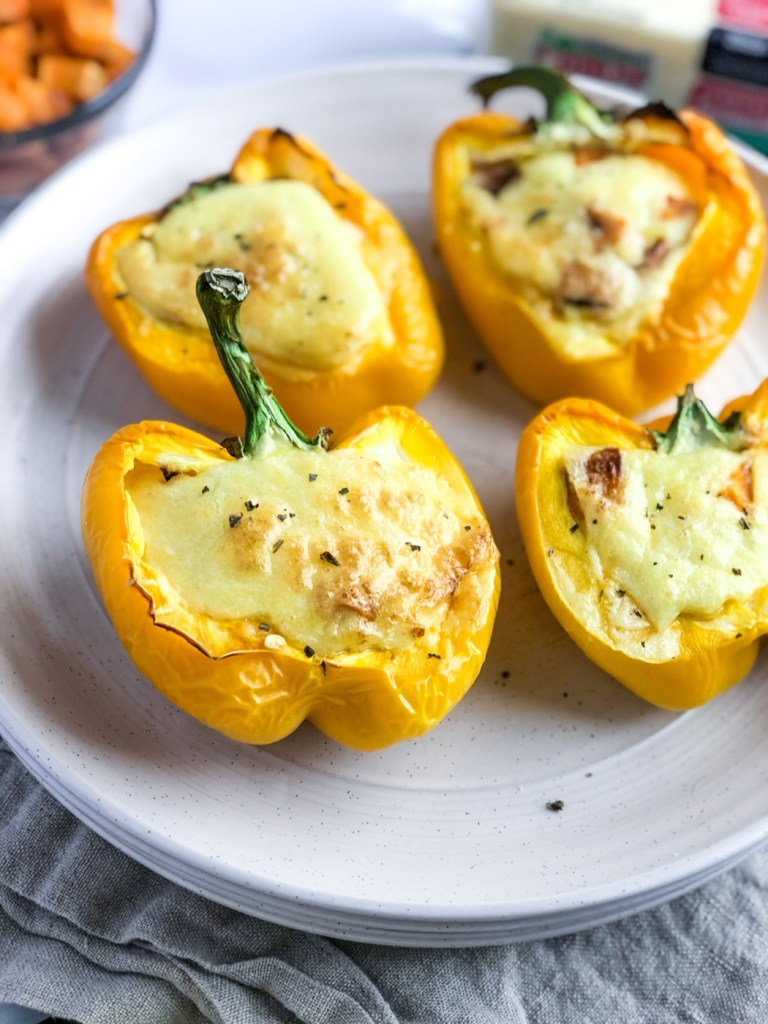 Plate of egg and cheese stuffed bell peppers