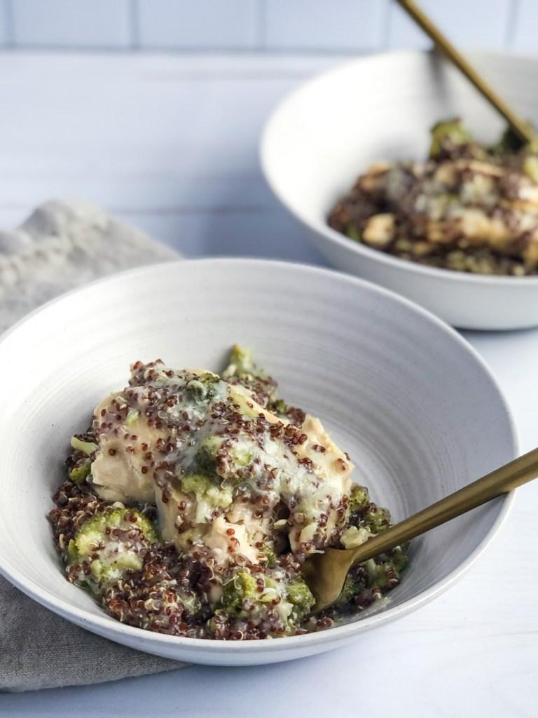 Digging into a bowl of healthy creamy chicken broccoli and quinoa casserole