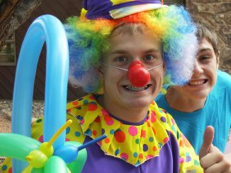"""Cole Barlow was a clown for the summer reading carnival at Rangely Library and Logan Osborne, behind Barlow, was a """"balloon-tying wizard."""""""