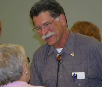 "Bill Kight visits with Sandy Shimko of White River Museum during a showing of the documentary film ""We Shall Remain — the Ute."""