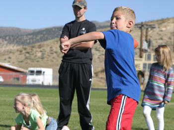 Cole Rogers prepares to throw during the Punt, Pass and Kick competition Sept. 28 in Meeker. He placed first in 7 and under.