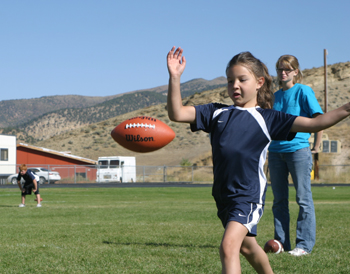 Third-grader Sydnie Main punts during the PPK event. She finished first in the 8-9 girls' age group.