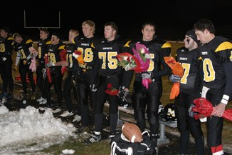 Senior members of Meeker's football team presented flowers to their parents prior to the start of last Friday's regular-season finale against Hotchkiss. The Cowboys play Saturday in the first round of the playoffs.