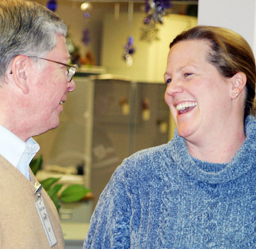 Bob Omer, Pioneers' chief executive officer, shared a laugh with Meeker Mayor Mandi Etheridge, who attended the open house. They both serve as trustees on the Meeker Town Board.