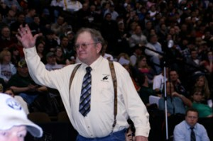 "Meeker assistant wrestling coach Sam Love was honored at the state tournament for 44 years of coaching. ""I have really enjoyed doing this for that many years,"" said Love, whose son Pat competed at state."