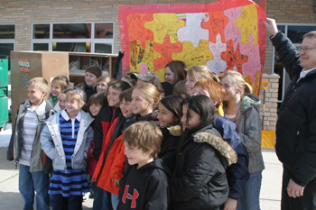Jeff Burkhead Student council members from Meeker Elementary School visited the new school Feb. 24 and presented a thank-you puzzle to workers on the project.
