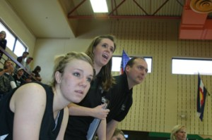 Stacey Fitzgibbons, who had fouled out, watched the action along with assistant coaches Kaleyne Turner and Mike Dinwiddie.