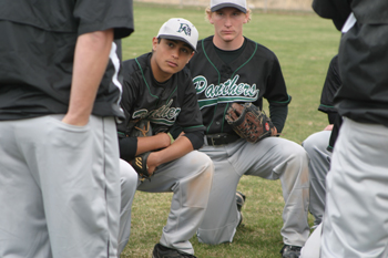 Rangely baseball players Chas Byerly, left, and Jason Stults listened to a post-game talk from coaches during a doubleheader against Meeker on April 17.