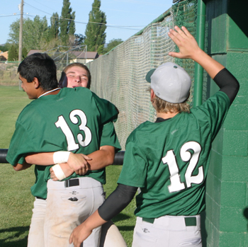 Chaz Byerly (13) and Lucas Heinle congratulated Bryson Palacios after he knocked in the go-ahead run Friday to spark Rangely's rally over league rival Meeker in the league championship game.