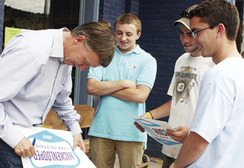 Hickenlooper signed a poster for Sam Love, Spencer Madison and Cameron Glasscock in front of the Meeker Hotel.
