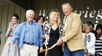 Brothers Randy, left, and Bud Striegel and sister Cheryl Olson cut the ribbon during a dedication ceremony last Friday for the W.C. Striegel Engineering Center.